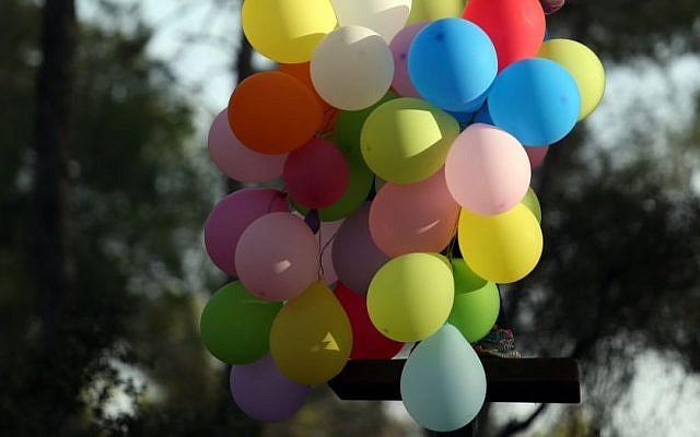 Birthday balloons (Nati Shohat/FLASH90)