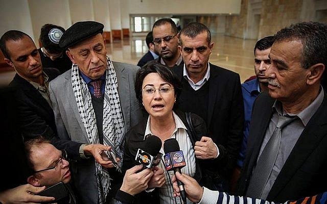 File: Joint (Arab) List MKs Hanin Zoabi (center),  Jamal Zahalka (right) and Basel Ghattas (center left, behind Zoabi) speak with the press in Jerusalem on February 17, 2015 (Hadas Parush/FLASH90)