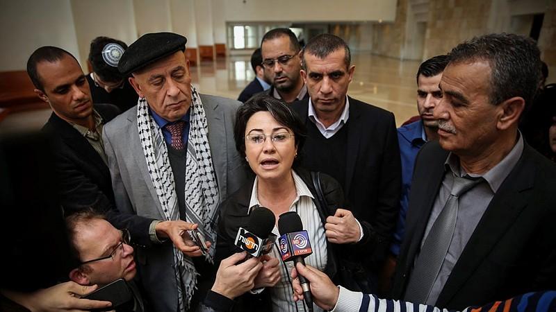 Joint (Arab) List MKs Hanin Zoabi (center), Jamal Zahalka (right) and Basel Ghattas (center left, behind Zoabi) speak with the press in Jerusalem on February 17, 2015 (Hadas Parush/FLASH90)