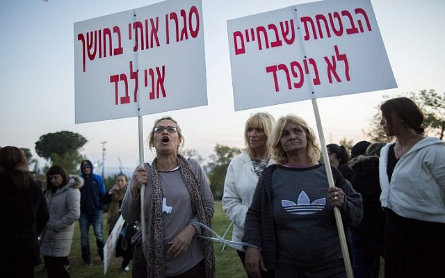 Parents and friends of young religious Jewish women attending a protest outside the Knesset, the Israeli parliament in Jerusalem on April 14, 2015, against what they believe to be Rabbi Aharon Ramati's emotional abuse and isolation of their daughters at his home in the Sanhedriya neighborhood of Jerusalem. April 14, 2015. (Yonatan Sindel/Flash90)