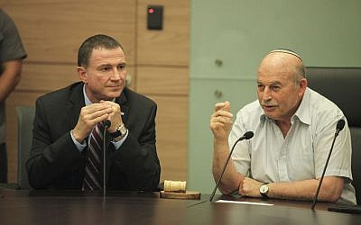 Knesset Chairman Yuli Edelstein, left, and MK Nissan Slomiansky attend the opening meeting of the Law and Justice Committee at the Knesset on June 1, 2015 (Isaac Harari/Flash90)