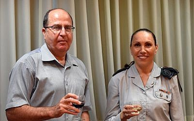 Col. Ariella Ben Avraham, Israel's chief military censor and Defense Minister Moshe Ya'alon on August 30, 2015 (Ariel Hermoni/Defense Ministry)