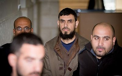 Khaled Koutineh, who ran over and killed Shalom Sherki last April, is brought to the Jerusalem District Court on February 1, 2016. (Yonatan Sindel/Flash90)