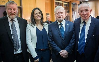 Outgoing Attorney General Yehuda Weinstein (right), State Comptroller Yosef Shapira (second right), Justice Minister Ayelet Shaked (second left) and incoming Attorney General Avichai Mendelblit (left) during the swearing-ceremony for the new attorney general, February 1, 2016. (Yonatan Sindel/Flash90)