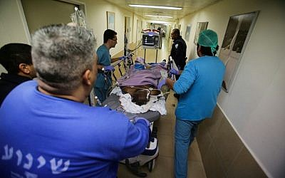 Medical personnel rush a suspected stabber into the emergency unit at Barzilai Hospital in Ashkelon on February 7, 2016. (Edi Israel/Flash90)