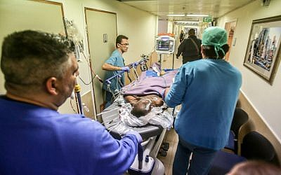 Medical personnel rush Kamel Hassan Mohammed into the emergency unit at Barzilai Hospital in Ashkelon after he stabbed a soldier in the southern city, on February 7, 2016. (Edi Israel/Flash90)
