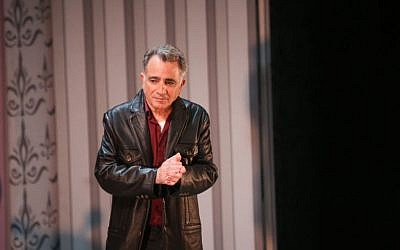 Actor Moshe Ivgy delivers a statement regarding sexual harassment allegations against him, at the end of a theater show in Tel Aviv on Sunday, February 7, 2016 (Flash90)