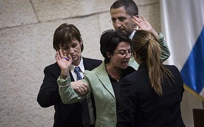 Joint List party member Hanin Zoabi is removed by Knesset security from the plenum after speaking for too long on February 8, 2016. (Hadas Parush/Flash90)