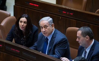Prime Minister Benjamin Netanyahu (flanked by ministers Miri Regev and Yisrael Katz) in the Knesset  on February 8, 2016. (Yonatan Sindel/Flash90)