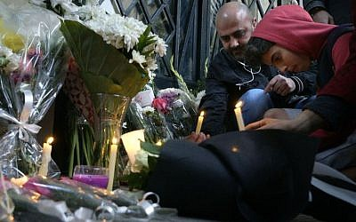Mourners attend a candlelight vigil for slain Italian graduate student Giulio Regeni in front of the Italian embassy in Cairo, Egypt, Saturday, Feb. 6, 2016. (AP Photo/Amr Nabil)