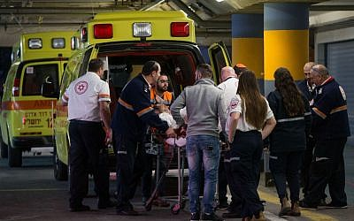 Medics wheel a wounded Israeli man, stabbed in a terror attack, into the emergency room of the Shaare Zedek Medical Center on February 9, 2016. (Yonatan Sindel/Flash90
