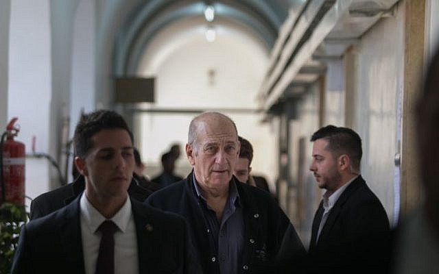 Former prime minister Ehud Olmert leaves the Jerusalem Magistrate's Court on February 10, 2016. (Ohad Zwigenberg/Pool)