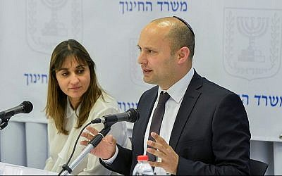 Minister of Education Naftali Bennett (right) seen with Education Ministry Director-General Michal Cohen at a press conference in Tel Aviv, February 18, 2016. (Flash90)