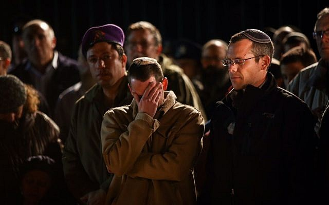 File: Hundreds attend the funeral of IDF reserve officer Eliav Gelman in Kfar Etzion, February 24, 2016. (Yonatan Sindel/Flash90)