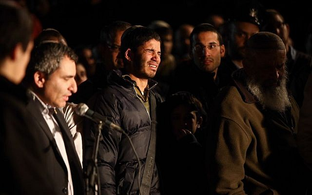 Immigrant Absorption Minister Ze'ev Elkin speaks during the funeral of IDF reserve officer Eliav Gelman in Kfar Etzion, February 24, 2016. (Yonatan Sindel/Flash90)
