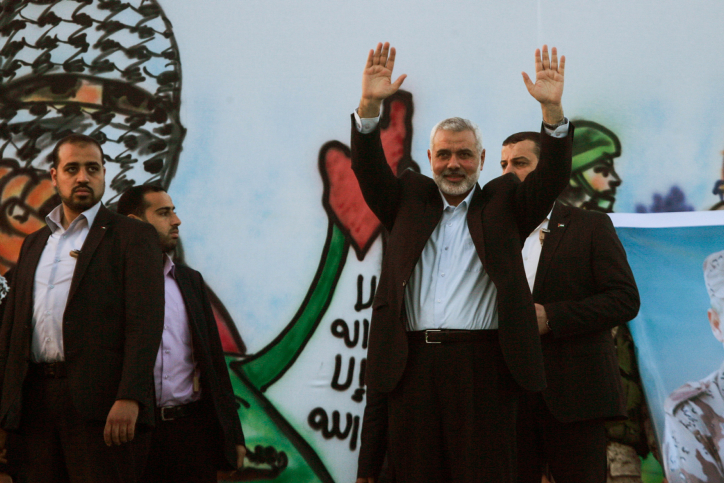 Head of the Hamas terror group, Ismail Haniya, waves to the crowd during an anti-Israel rally in the southern Gaza Strip city of Rafah on February 26, 2016. (Abed Rahim Khatib/Flash90)