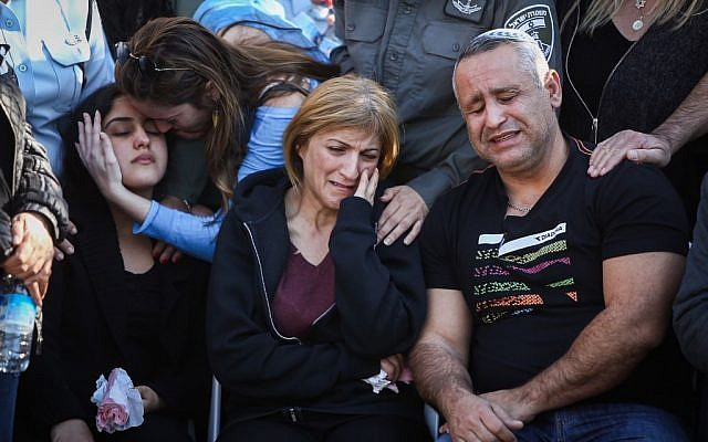 The family of Hadar Cohen, 19, at her funeral in Yehud, on February 4, 2016. Cohen was killed by Palestinian gunmen near Damascus Gate in Jerusalem on February 3. (Yonatan Sindel/Flash90)