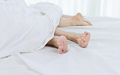 A couple in bed (iStock via JTA)