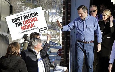 Republican presidential candidate Sen. Ted Cruz, R-Texas, waves as he leaves a campaign event, Sunday, Feb. 7, 2016, in Peterborough, New Hampshire. (AP Photo/Elise Amendola)
