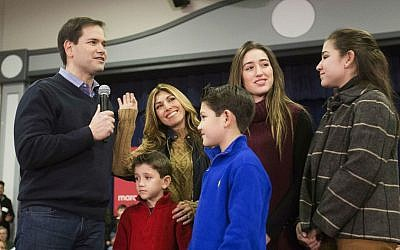 Republican presidential candidate Senator Marco Rubio, R-Florida, left, is joined by his wife Jeanette and their children, from left, Dominic, Anthony, Amanda, and Daniella, at a campaign event at Gilbert H. Hood Middle School Friday, Feb. 5, 2016, in Derry, New Hampshire. (AP Photo/David Goldman)