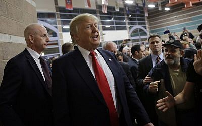 Republican presidential candidate Donald Trump visits a caucus site, Tuesday, February 23, 2016, in Las Vegas (AP Photo/Jae C. Hong)