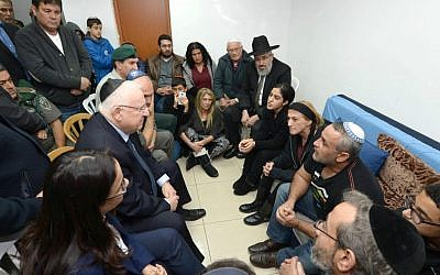 President Reuven Rivlin meets on February 8, 2016 with the family of slain border policewoman Hadar Cohen, who was killed five days earlier in a terror attack at Damascus Gate in Jerusalem. (Mark Neyman/GPO)