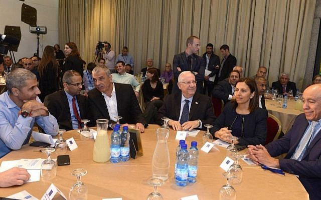 President Reuven Rivlin (third from right) meeting with Social Equality Minister Gila Gamliel (second right), Zionist Union MK Zouheir Bahloul (right), Finance Minister Moshe Kahlon (third from left) and leaders of the Arab Israeli public, on February 24 2016. (Mark Neyman/GPO)