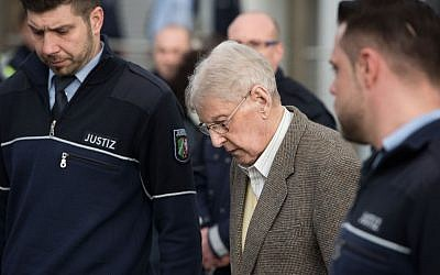 94-year-old former SS guard at the Auschwitz death camp Reinhold Hanning, center, leaves the building after the opening of his trial in Detmold, Germany, Thursday, Feb. 11, 2016.  (Bernd Thissen/Pool Photo via AP)