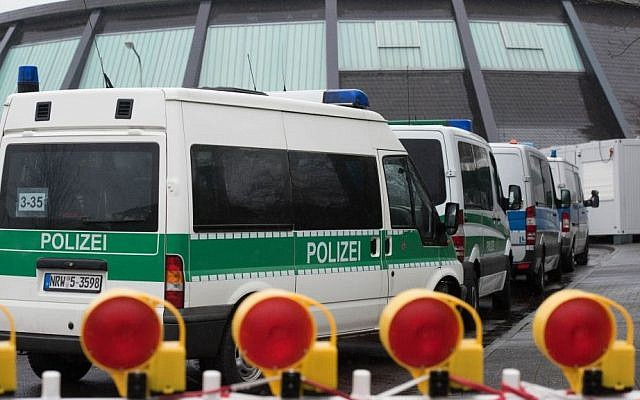 Police vehicles park in front of the reception facility for refugees located in a gymnasium in Attendorn, Germany, Thursday Feb. 4, 2016.  (Bernd Thissen/dpa via AP)