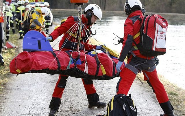 Rescue teams salvage an injured person at the site of a train accident near Bad Aibling, Germany, Tuesday, Feb. 9, 2016 (Uwe Lein/dpa via AP)