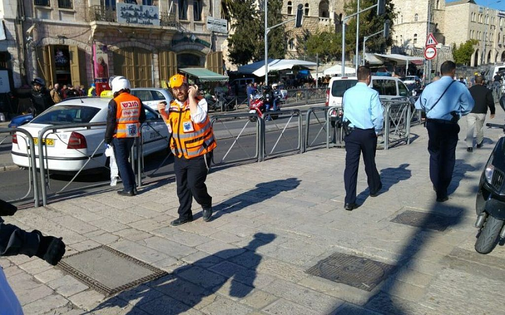 Police and medics at the scene of a shooting attack outside the Damascus Gate of Jerusalem's Old City  on Wednesday, February 3, 2016 (Hatzalah)