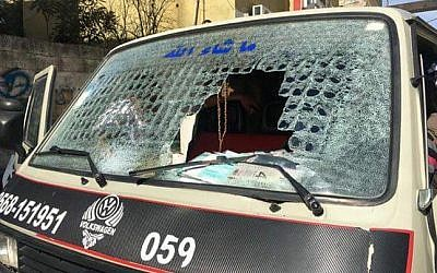 The windshield of a Palestinian vehicle, which was  smashed by an Israeli settler with an ax outside of the Karnei Shomron settlement on February 10, 2016. (Zachria Sadah/Rabbis for Human Rights)