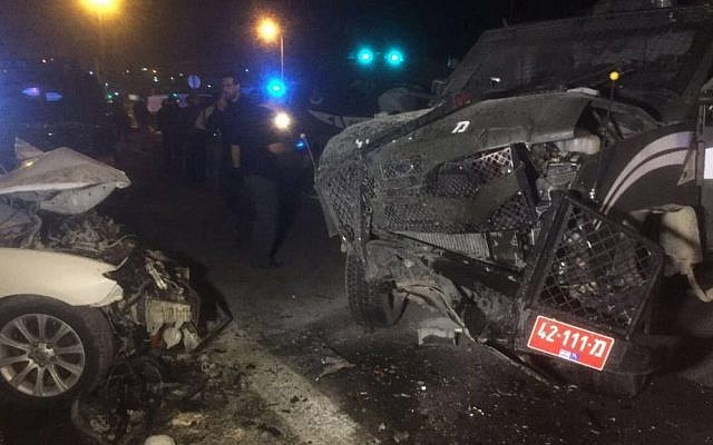 The scene of a crash near Ma'ale Adumim after a car carrying suspects (left) rammed a Border Police car, injuring three, February 13, 2016 (Israel Police)