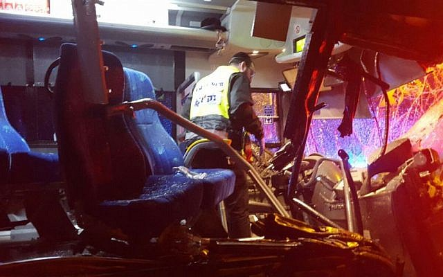 The scene of a deadly bus-truck collision on Route 1 on February 14, 2016 (ZAKA)