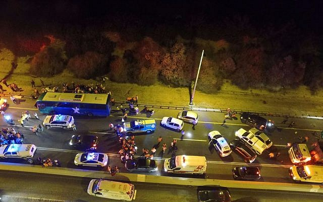 The scene of the deadly bus-truck collision on Route 1 (United Hatzalah)