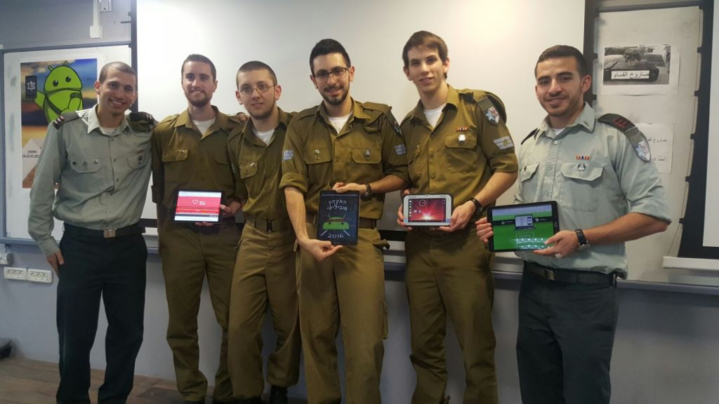 Rotem (L) and Dean (R ) flank hackers at the Mobility Hackathon (Courtesy)