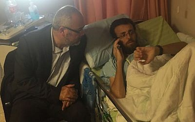 Palestinian hunger striker Mohammed al-Qiq with Joint (Arab) List MK Osama Sa'adi at the Emek Medical Center in Afula, on February 26, 2016. (Courtesy Joint List)