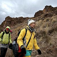 In this Tuesday, Jan. 19, 2016 photo, Iranian rock climber, Farnaz Esmaeilzadeh, center, approaches cliffs in a mountainous area outside the city of Zanjan, some 330 kilometers (207 miles) west of the capital Tehran, Iran. (AP Photo/Ebrahim Noroozi)