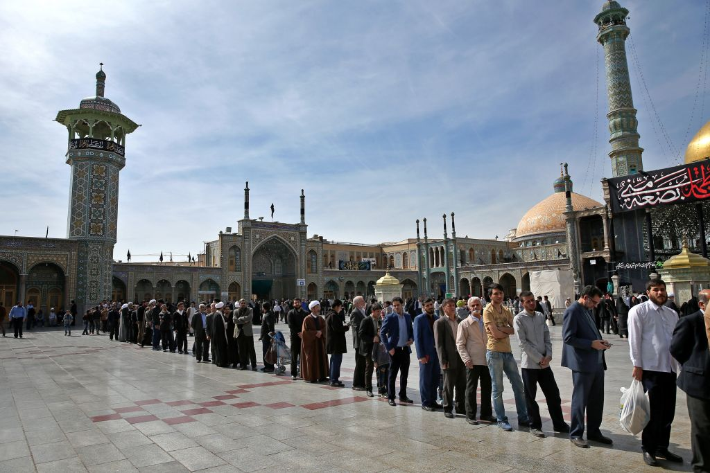 Iranians stand in line at a polling station during the parliamentary and Experts Assembly elections in Qom, 125 kilometers (78 miles) south of the capital Tehran, Iran, Friday, Feb. 26, 2016. (AP Photo/Ebrahim Noroozi)