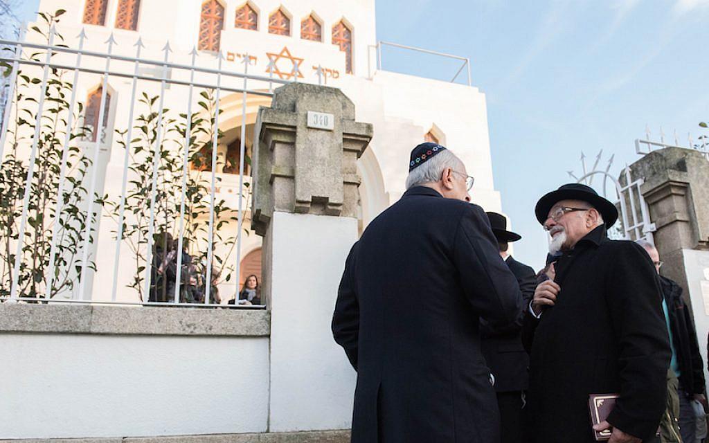 Turkish Chief Rabbi Ishak Haleva, right, talking to congregants outside Kadoorie – Mekor Haim synagogue in Porto, Portugal, Jan. 29, 2016 (Cnaan Liphshiz/JTA)