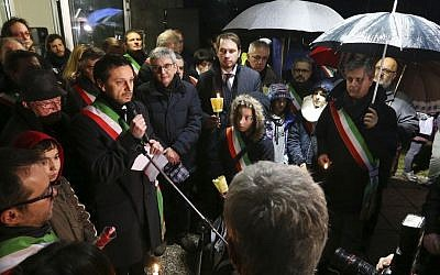 Fimuicello's Mayor Ennio Scridel delivers his speech during a candle lights procession to honor the memory of Giulio Regeni in his hometown of Fiumicello, Italy on Feb. 7, 2016. (AP Photo/Paolo Giovannini)