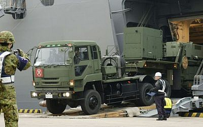 A vehicle carrying a PAC-3 missile interceptor arrives at a port on Ishigaki Island, Okinawa prefecture, southwestern Japan Saturday, Feb. 6, 2016, intended to fend off the threat of North Korea's missile arsenal. (Koji Harada/Kyodo News via AP)