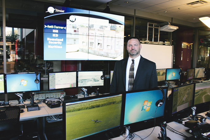 Sinclair Community College Assistant Vice President of Workforce Development Jeffrey Miller at Sinclair's National UAS Training and Certification Center, which relies on Simlat training systems (Marshall Weiss, The Dayton Jewish Observer)