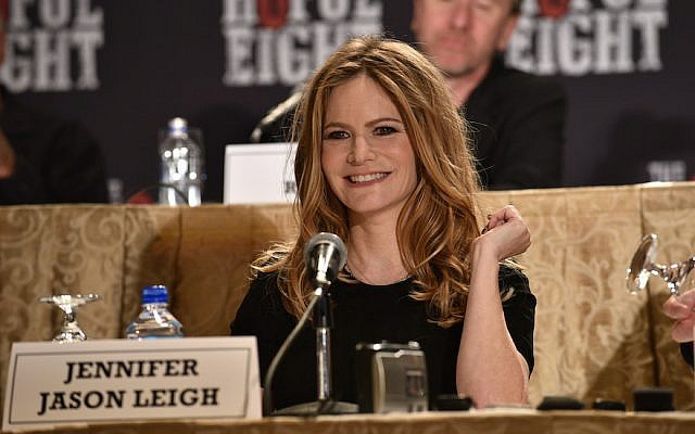 """Jennifer Jason Leigh speaking at a press conference for """"The Hateful Eight"""" at the Waldorf Astoria Hotel in New York City, Dec. 14, 2015. (Bryan Bedder/Getty Images for The Weinstein Company, via JTA)"""