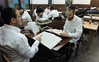 Lubavitcher Hasidim in Kfar Chabad studying Talmud at 770, a brick-for-brick replica in Israel of Chabad headquarters in Brooklyn. (Ben Sales)