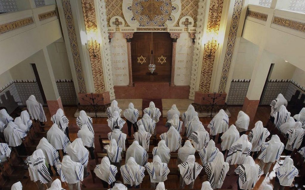 Congregants praying at the Kadoorie – Mekor Haim synagogue in Porto, Portugal, May 2014. (Courtesy of the Jewish Community of Porto)
