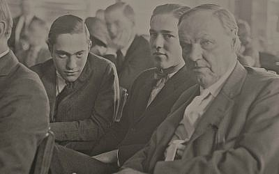 Nathan Leopold, left, and Richard Loeb, center, sitting in the courtroom with their defense attorney, Clarence Darrow, right. on July 24, 1924. (Courtesy of Chicago History Museum/via JTA)