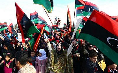 FILE: Libyans celebrate on February 17, 2015 ahead of the upcoming fourth anniversary of the Libyan revolution which toppled dictator Muammar Gaddafi. (MAHMUD TURKIA / AFP)
