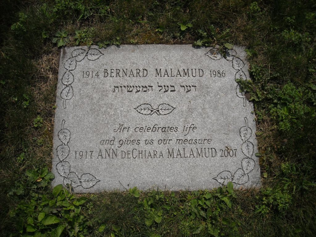 Monument for author Bernard Malamud, buried at Mount Auburn Cemetery in Cambridge, Massachusetts. The Yiddish says, 'The master of stories.' (courtesy: Joshua Segal)
