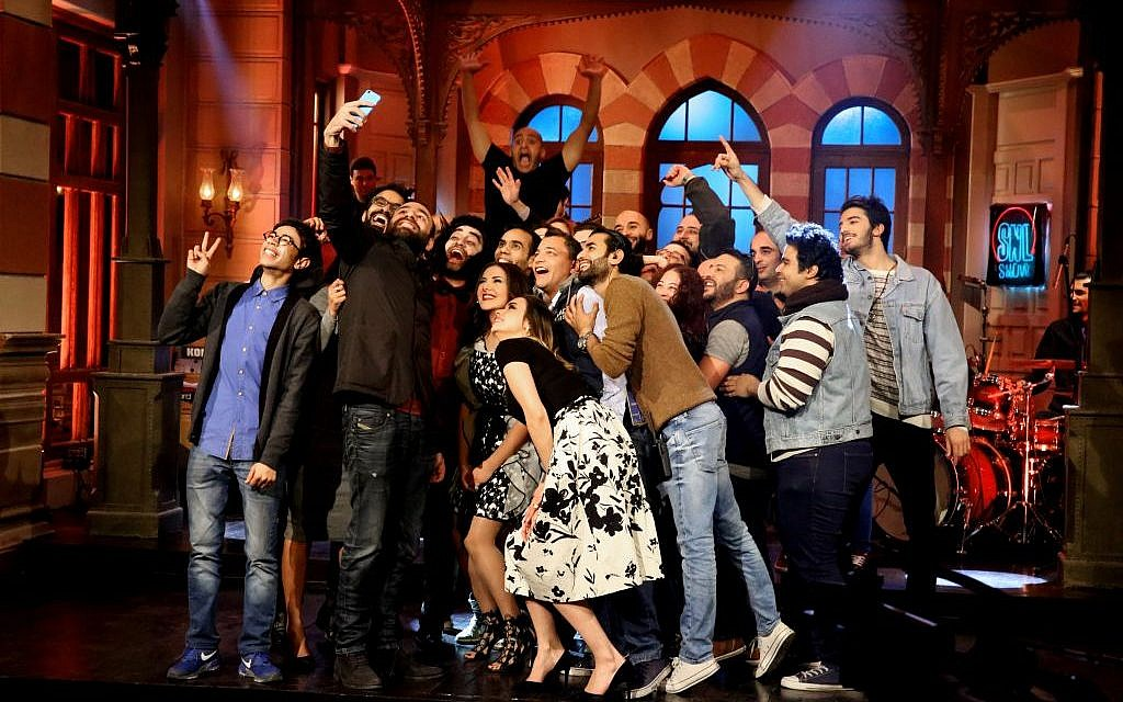 "This photo from February 16, 2016, provided by OSN, shows actors taking a 'selfie' at the end of OSN's ""Saturday Night Live Arabia,"" show in Cairo, Egypt.  (OSN via AP)"